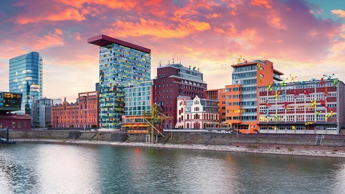Colorful spring sunset on Rhine river in Dusseldorf. Medienhafen in the soft sunset light, Nordrhein-Westfalen, Germany, Europe.