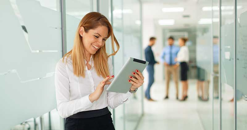 Young business woman looking at tablet