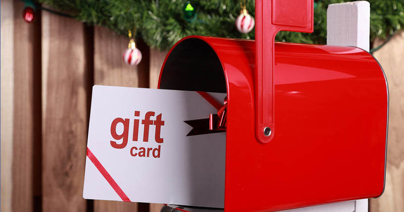 US mailbox open with gift card inside